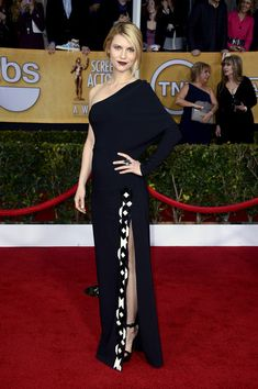 Claire Danes brought the drama in her dark lip and artistic single-sleeve gown. Brand: Givenchy