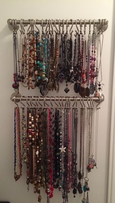 Jewelry organization using towel bar and shower curtain hooks for necklaces