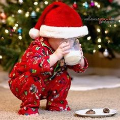 Too cute! Baby Christmas photo. Santa hat, milk, and cookies with tree in background