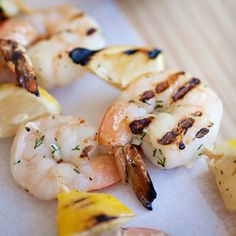 Shrimp and Lemon Skewers with Feta Dill Sauce - Squeeze the charred lemons over the shrimp before serving for a tangy, smoky hit of flavor. You may want to make extra feta sauce to have with lean lamb steaks or chicken skewers. Shrimp Recipes, Sauce Recipes, Fish Recipes, Grub Recipes, Grilling Recipes, Dill Sauce, Yogurt Sauce, Grilled Seafood, Food Porn