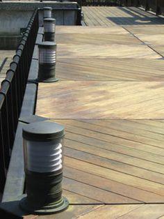 lighting fixtures along the edge of an outdoor deck
