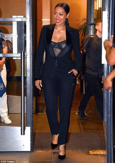 She dares to bare: La La Anthony showed off her assets in this revealing tuxedo from designer Tom Ford when she was spotted out on Tuesday in Manhattan