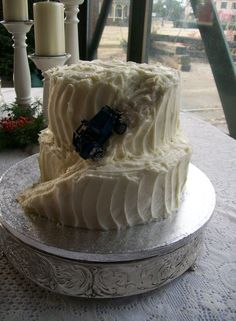 The groom loves his jeep, and the secret family recipe from-scratch carrot cake with cream cheese icing. His cake takes that into account. :-)