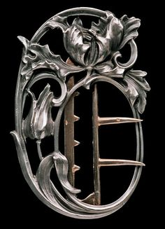 This is not contemporary - image from a gallery of vintage and/or antique objects.  CHARLES MURAT  Art Nouveau Tulip Buckle  Silver Gold