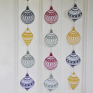 Deck the halls with Baubles ! Original 5 Bauble lino printed Garland Each shape is hand carved out of a block of lino and individually printed in beautiful bright colours. Each is hand burnished onto paper which is then mounted on card before sha...
