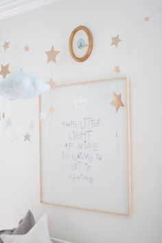 Oooh. Dreamy gold star decor in the nursery hung just above the crib.