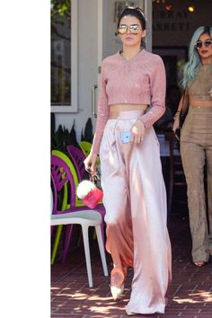 The model went shopping in West Hollywood with sister Kylie, wearing a Jonathan Simkhai crop top and flowing trousers in soft shades of blush with Sophia Webster nude pumps.