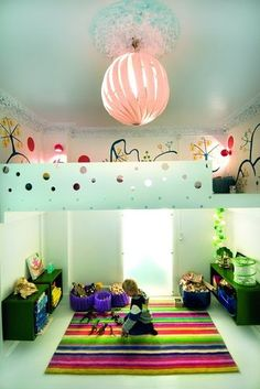 This colourful plaroom features a large loft (for sleeping?) and a fantastic mural within.