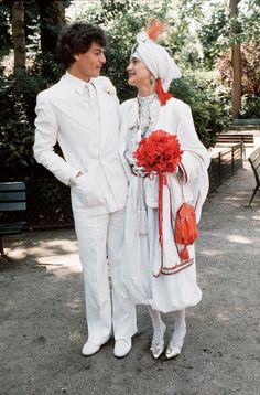 Loulou de la Falaise getting married to the writer and intimate of the YSL–set Thadée Klossowski de Rola, son of the artist Balthus (1977).  For the ceremony, the handsome Thadée was dressed entirely in white, and his bride, who was dressed as a sixteenth-century maharaja in harem pants, sported a turban sprouting a flame-colored aigrette and carried a fistful of beribboned anemones.