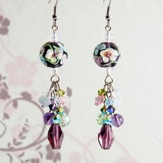 This is my personal favorite earring set. It contains a total of 28 different stones and crystal elements. Made from semi precious stones like aquamarine, opal, amethyst & rose quartz.  The 2 big flower beads are handmade and has delicately crafted flowers in the glass beads. All crystal elements used are from the cyrstallized Swarovski Elements. It contains all shapes and sizes including butterfly shaped.  This item is carefully and lovingly hand crafted by myself. Thank you for your…