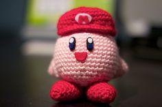 Crocheted Kirby I made for John :). Pattern here: http://www.ravelry.com/patterns/library/kirby---super-smash-brothers-edition