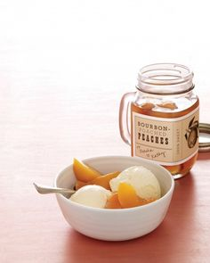 Bourbon-Poached Peaches  Summer's sweetest fruit is perfect when you simmer it in a heady bourbon syrup and pack it into jars. Pour it over ice cream, stir it into a cocktail, or -- our favorite -- eat it with a spoon.