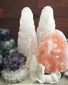 Selenite towers, Himalayan salt, amethyst cluster, underneath is quartz as well as the free-standing piece, and fluorite in the back left.