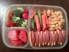sugar snap peas, baby carrots, broccoli, cherry tomatos,summer sausage, colby cheese, pasta salad, and watermelon.