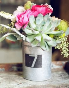 succulent arrangement- perfect for table numbers at a wedding