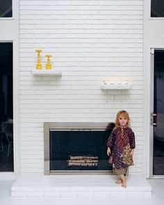 fireplace remodel ideas...but would add a long mantle across, not two separate small ones.