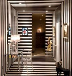 Week 3: Rhythm through Opposition-By contrasting the black & white stripes in different directions, it pulls your eye around, across, & into the room.