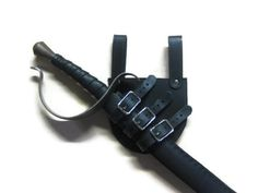 Hey, I found this really awesome Etsy listing at http://www.etsy.com/listing/154636181/black-leather-cutlass-sword-hanger