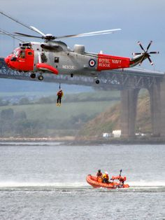 A search and rescue helicopter from HMS Gannet demonstrates how it works with the lifeboat.