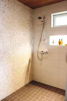 Loving the combination of two different wall tiles (not the colours though) and the shelf with LED lighting
