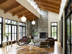 Raw wood beams in vaulted ceiling and sawtooth skylights