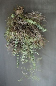 Hanging decoration made of wispy twigs + delicate greens
