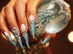 Unleash your inner snow queen with these bejeweled icicle nails fit for royalty.