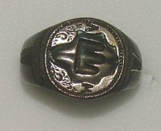 Signet ring Italy 14th century Silver signet ring, circular bezel with a shield of arms between the letters M and A, a circular hoop with inscriptions RESPICE.FINEM.SAPIENS.ESTO and SI DEUS. PRO NO/BIS.QUIS.CON [TRA NOS] (If God is for us, who shall be against us? Study your end: be wise) (engraved in Lombardic letters) 19.96 mm internal ring diameter; 12.44 g weight