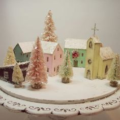 Handmade Christmas village. Cute idea.