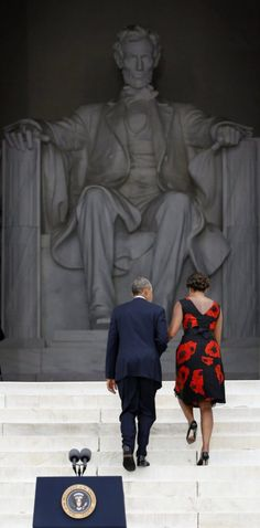 President Obama and Michelle Obama climb the steps of the Lincoln Memorial on the 50th anniversary of the March on Washington.