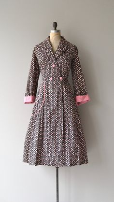 Vintage late 1940s, early 1950s black cotton wrap dress with pink strawberry print, pink piped trim, double breasted button waist, tie waist, revers