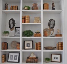 love the little plants in pots on these shelves and everywhere throughout this house in the other pics