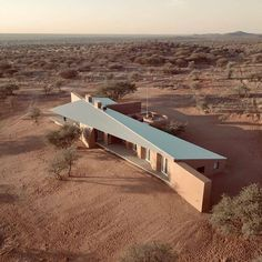 slee & co. architects' red earth game lodge emerges from the namibian landscape Earth Games, Farm Gate, Corrugated Roofing, Game Lodge, Earth Color, Vernacular Architecture, Residential Architecture, Exterior, Metal Roof