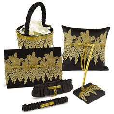 Our gorgeous black, satin collection with gold lace and glitter ribbon includes a guest book, pen set, pillow, basket, and garter!
