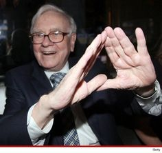 """Super-elite, multi-billionnaire Warren Buffett at a party organized by Jay-Z. As TMZ now likes to say, he's """"throwing up the Illuminati sign""""."""