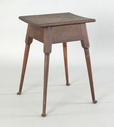 """Pook & Pook.  October 30th 2010.   Lot 362.  Estimated: $1500 - $2500.   Realized Price: $5688.   Pennsylvania walnut splay leg stand, late 18th c., with turned splay legs terminating in pad feet, 28 1/2"""" h., 20"""" w."""