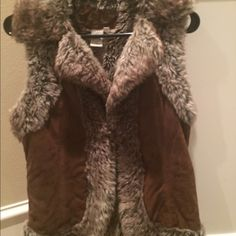 Price firm. Leather and fur vest Like New!! Pre loved leather and fur vest. Wouldn't get rid of it, if it still fir me. Has one button closure. Great for this cold weather. Size S Jackets & Coats Vests