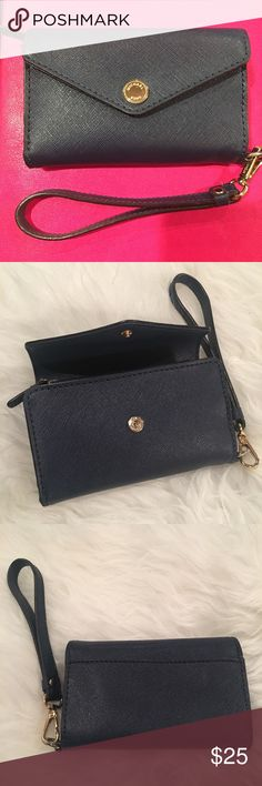 Michael Kors wristlet iPhone 5 blue wallet Used in good condition. A wristlet for ID, Credit card, loose change. Slip pocket on the back exterior. Detachable strap. This fits an iPhone 5/5s. Please see photos for flaws on the interior stitching.  Offers welcome. Please ask any and all questions. Thanks! Michael Kors Bags Clutches & Wristlets