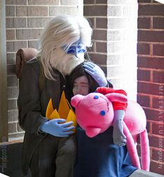This is a series of photographs from Mineralblu Photography of some Twinzik cosplayers dressed as Simon Petrikov (the future Ice King) and Marceline from Adventure Time.