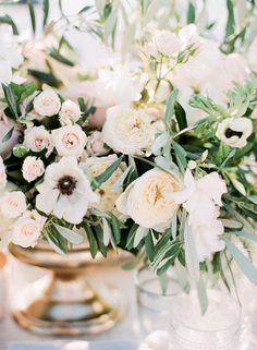 FOR THE FLOWERS || Bouquet arrangements in gold vases with soft pinks, whites and apricots || NOVELA...where the modern romantics play & plan the most stylish weddings...Instagram: @novelabride www.novelabride.com