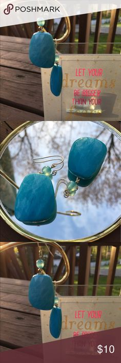 Beautiful Chunky Aqua Drop Earrings Lovely blue drop earrings with gorgeous, lightly marbled, aqua-colored stones, each accented by a tiny sky-blue bead. Gold tone fishhook backs. Jewelry Earrings