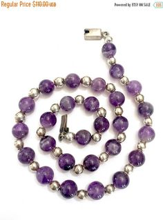Moms Sale     Taxco Amethyst & Sterling Silver Beaded Necklace  Measures: Approx. 19 Amethyst beads approx. 10mm Sterling Silver beads approx. 6mm  Mark: Mexico 925  Condition: Very Good vintage condition  What a wonderful Mexican silver necklace ~ we just love it! Composed of stunning natural amethyst beads that are approx. 10mm in size. The amethyst beads alternate with sterling silver beads that are are approx. 6mm. The necklace has a fantastic total gram weight of 44.2 grams. Beautif...