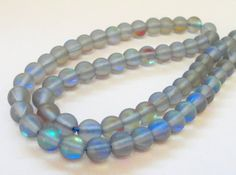 Small Blue Synthetic Moonstone Beads  Sparkly Fire by BijiBijoux, https://www.etsy.com/listing/197967835/small-blue-synthetic-moonstone-beads