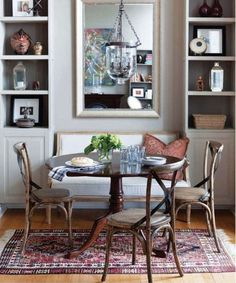 "Would love to create a cozy dining nook . . . and some storage - either shelves, pie pantry, or buffet . . love the rug idea too.  And mixing chairs with a bench or ""built in"" approach.:"