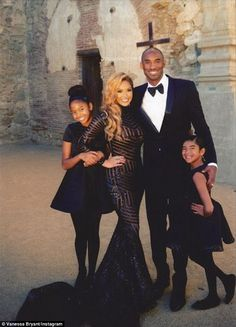 Kobe Bryant and wife Vanessa pose with their two daughters -Natalia, 11, and Gianna, eight - in their 2014 family Christmas card