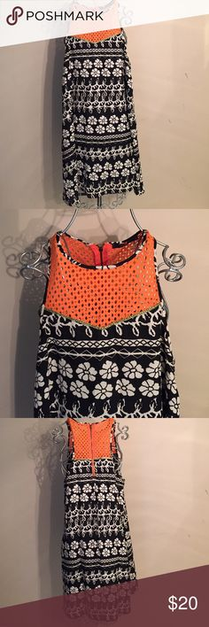 THML size medium dress! NWOT black floral NWOT THML black with tan floral design bottom and top orange eyelet bodice with gold edging. Zipper in back, fully lined! Light and flowy!! Smoke free pet free home!! 34' length, 17' chest THML Dresses Midi