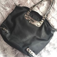 """JUST REDUCED! Rebecca Minkoff Nylon Tote! Rebecca Minkoff Nylon Tote. Excellent condition. Looks like it did the day I got it. Inside is one big open space with small zipper pocket shown in last picture. Very well made bag! No trades. 12""""W x 12""""H Rebecca Minkoff Bags Totes"""