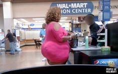 People shopping in Wal-Mart