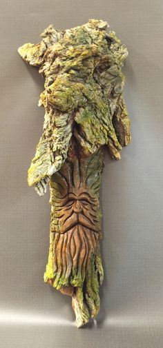A personal favorite from my Etsy shop https://www.etsy.com/listing/279756020/hand-carved-original-green-man-wood