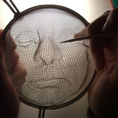By manipulating kitchen strainers and shining light through them, lovely portraits are created from the resulting shadows.